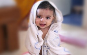 Child wrapped in towel